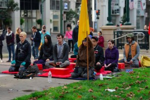 Members of the Berkeley Shambhala Center sitting at a recent protest in Oakland.